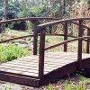 Small wooden garden bridge by Berkshire Log Stores. Buy wooden bridges for your garden online