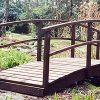 Small wooden garden bridge by Berkshire Log Stores. Buy wooden bridges for your garden online